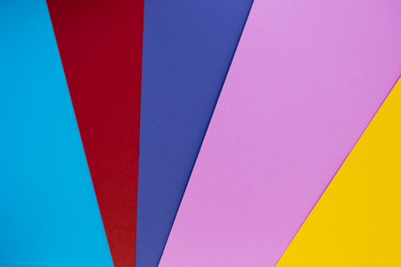 Multicolor background from cardboard paper. blue red purple pink yellow pastel color Stock Photo