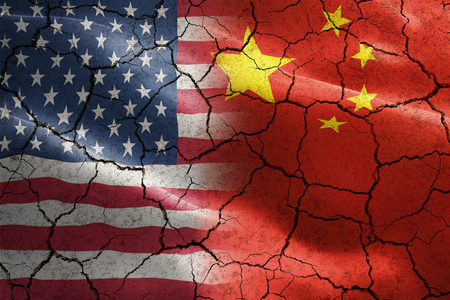 Flag of United States of America against China in cracked texture - indicates negative impact and conflict between these two countries such as international economy, trade war, partnership Stock Photo