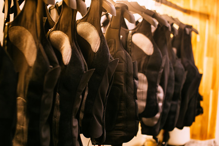 Many of electric EMS fitness training suits being hung inside - electrical shocking technology and science method of workout training