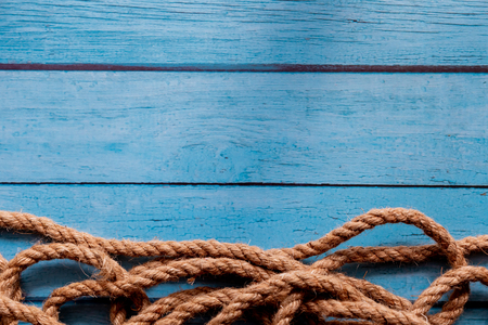 Rope on blue wooden textured background - nautical and sailing concept backdrop Stock Photo