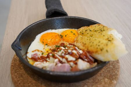 Asian fried egg pan cuisine in Thai traditional style servied on table - Very popular menu from Northern part of Thailand