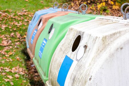 Row of old white, green and colorful trash bin in the community in Germany, Europe Reklamní fotografie