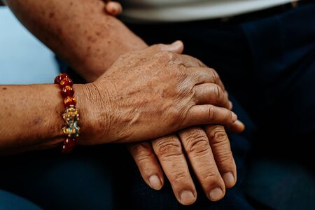 Close up of hand of elderly woman holding hands of old man. Romantic love lasting forever concept