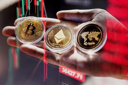 Close up of Bitcoin and Cryptocurrency stock market exchange candlestick chart. Red bearish divergence indicator