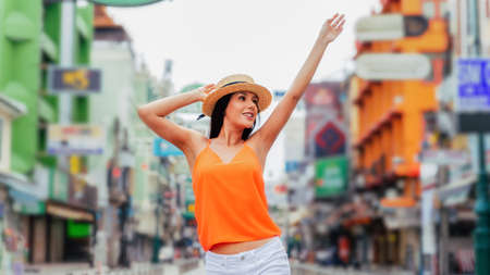 Young brunette woman traveling with attractive toothy smile. Happy and excited Hispanic girl traveler wear summer clothes with hat.