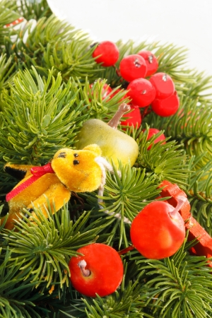 adventskranz: Christmas Decoration with pine cones, ornaments, baubles, apples, wooden horses, nutcracker and other toys  Stock Photo
