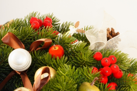 Christmas Decoration with pine cones, ornaments, baubles, apples, wooden horses, nutcracker and other toys  Stock Photo