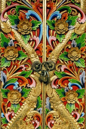 old closed wooden doors with ornaments and lock 스톡 콘텐츠