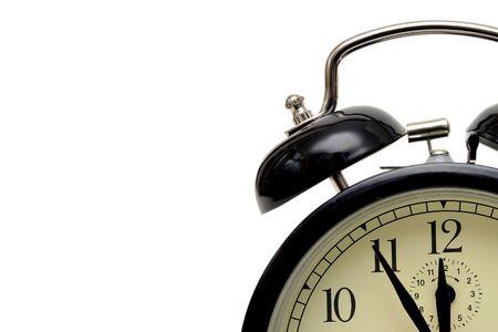 alarmclock: alarm-clock set five minutes to twelve isolated on white background