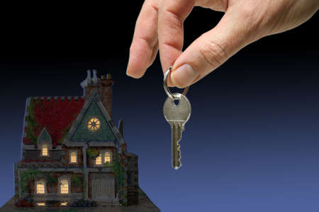 home at night with hand and key