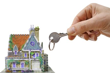 house with hand and key, a new home isolated on white background photo