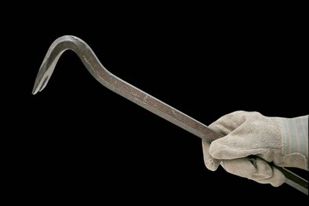 thievery: crowbar with glove isolated on black background clipping path embedded Stock Photo