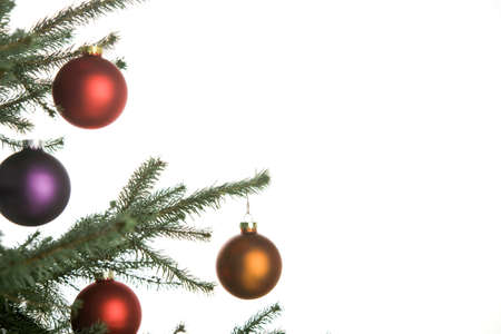 decoratiion: christmas border of pine-tree with ornaments on white background Stock Photo