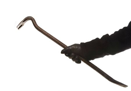 thievery: thief or burglar with crowbar and leather glove isolated on white background Stock Photo
