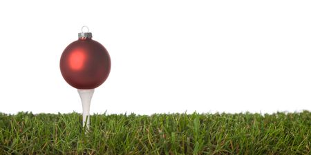 tee: christmas golf-ball isolated on a white background .with plenty of copy-space