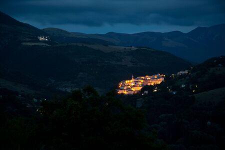 italian village of preci at night photo