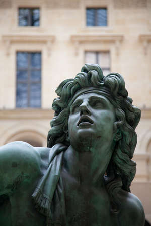 bronze sculpture inside louvre museum in paris 2010