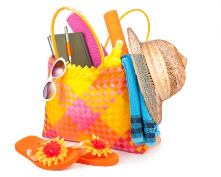 beach bag with towel sunglasses flip-flops and hat.isolated on white photo