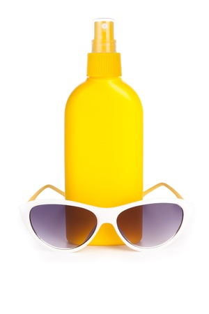 sunblock: sunblock cream and sunglasses. isolated on a white background with a smooth reflection