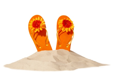 flip-flops on a sunny pile of sand 스톡 콘텐츠