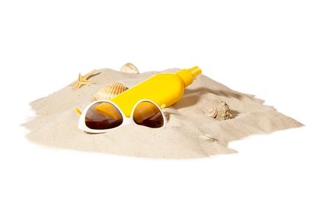 beach items on a sunny pile of sand Stockfoto