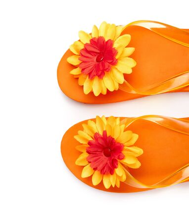 orange flip-flops with flowers on a white background photo