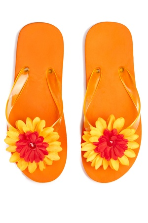 sandals: orange flip-flops with flowers on a white background