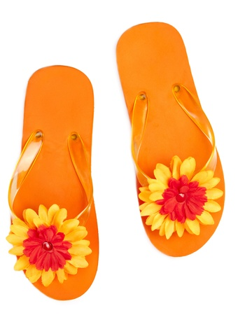 flipflops: orange flip-flops with flowers on a white background