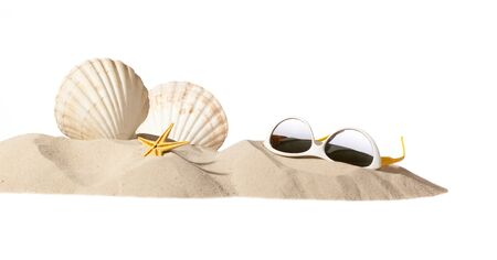shell and sunglasses on beach, isolated on a white background,with a lot of copy-space photo