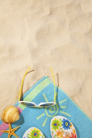 beach items on a towel with copy-space Stock Photo