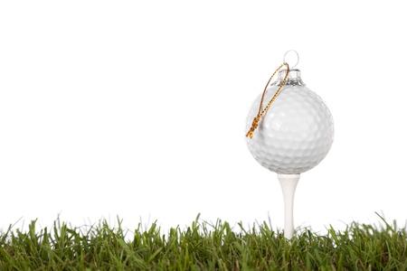 kerst golf-bal geïsoleerd op een witte achtergrond met veel kopie-ruimte Stockfoto
