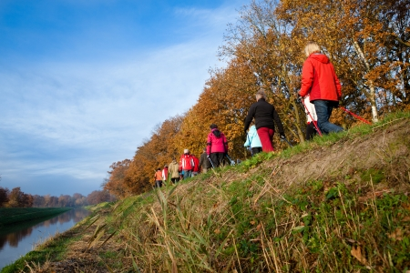 group of senior hikers doing  outdoor sports