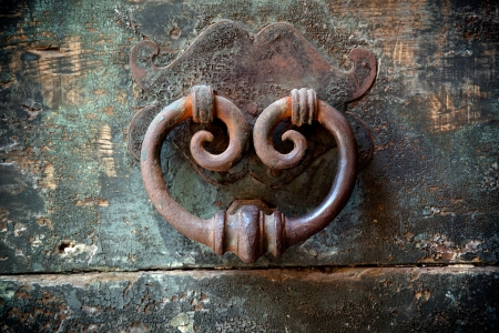 antique door-knocker on old door with beautifull texture Stock Photo
