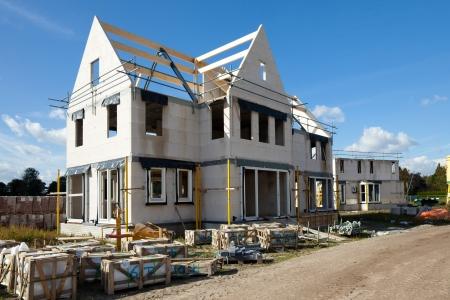 bouwwerf bouw van een nieuw bakstenen huis Stockfoto