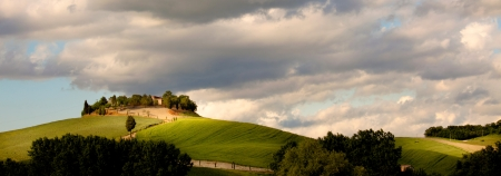 agriturismo: typical tuscan countryside with farm and meadow