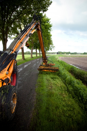 road tractor: mowing grass along roadside