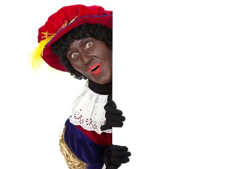 Zwarte piet   black pete  typical Dutch character part of a traditional event celebrating the birthday of Sinterklaas in december over white background   Stock Photo - 18208854