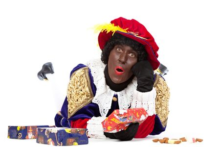 black pete: Zwarte piet   black pete  typical Dutch character part of a traditional event celebrating the birthday of Sinterklaas in december over white background