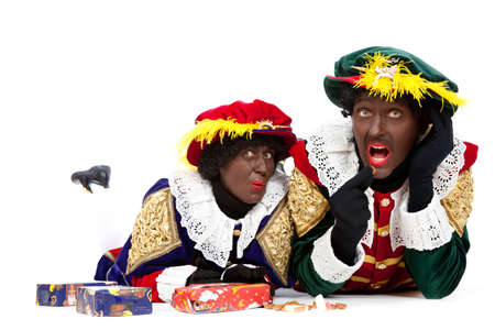 Zwarte piet   black pete  typical Dutch character part of a traditional event celebrating the birthday of Sinterklaas in december over white background   Stock Photo - 18208865