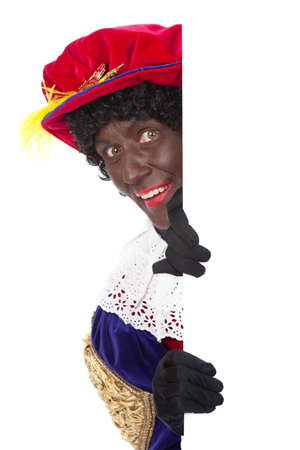 Zwarte piet   black pete  typical Dutch character part of a traditional event celebrating the birthday of Sinterklaas in december over white background   Stock Photo - 18208860