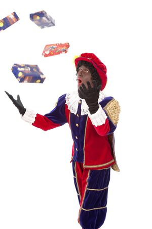sint nicolaas: Zwarte piet   black pete  typical Dutch character part of a traditional event celebrating the birthday of Sinterklaas in december over white background