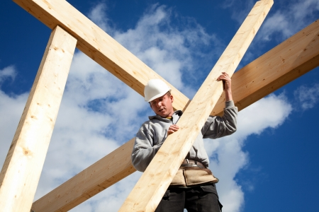 work belt: carpenter at work with wooden  roof construction