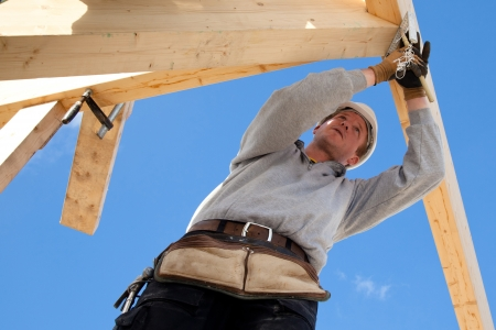 carpenter at work with wooden  roof construction Stock Photo - 18258192