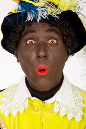 advertize: zwarte piet   black pete   typical Dutch character part of a traditional event celebrating the birthday of Sinterklaas in december
