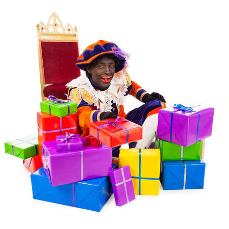 saint nicolaas: zwarte piet black pete with presents typical Dutch character part of a traditional event celebrating the birthday of Sinterklaas in december