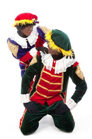 zwarte: zwarte pieten   typical Dutch character part of a traditional event celebrating the birthday of Sinterklaas in december