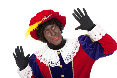 sint nicolaas: zwarte piet   typical Dutch character part of a traditional event celebrating the birthday of Sinterklaas in december