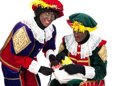 saint nicolaas: zwarte pieten   typical Dutch character part of a traditional event celebrating the birthday of Sinterklaas in december