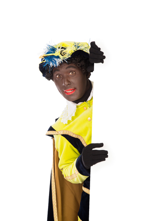 zwarte piet   black pete   clipping path included  typical Dutch character part of a traditional event celebrating the birthday of Sinterklaas in december photo