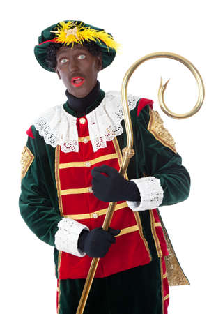 saint nicolaas: zwarte piet   typical Dutch character part of a traditional event celebrating the birthday of Sinterklaas in december